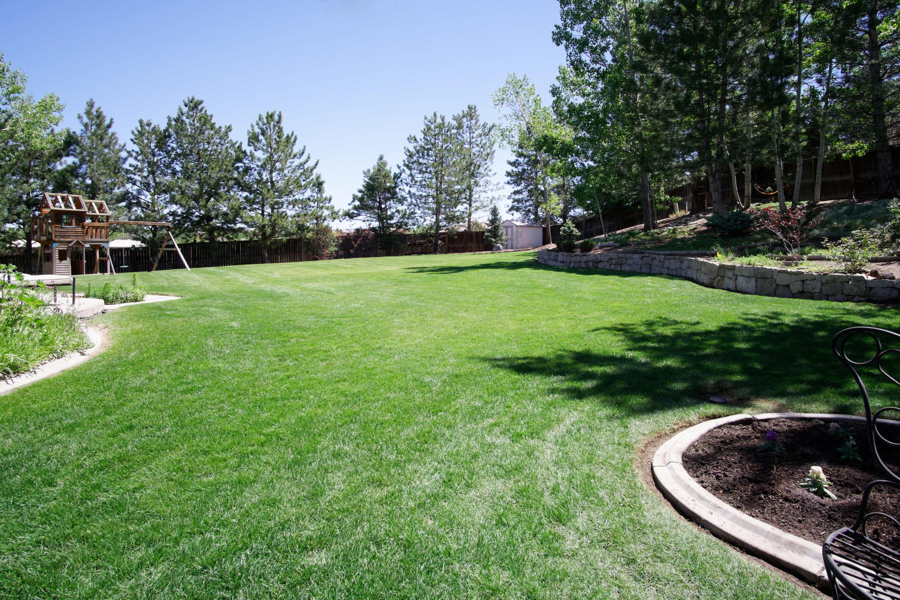 incredible park like backyard specializing in highlands ranch