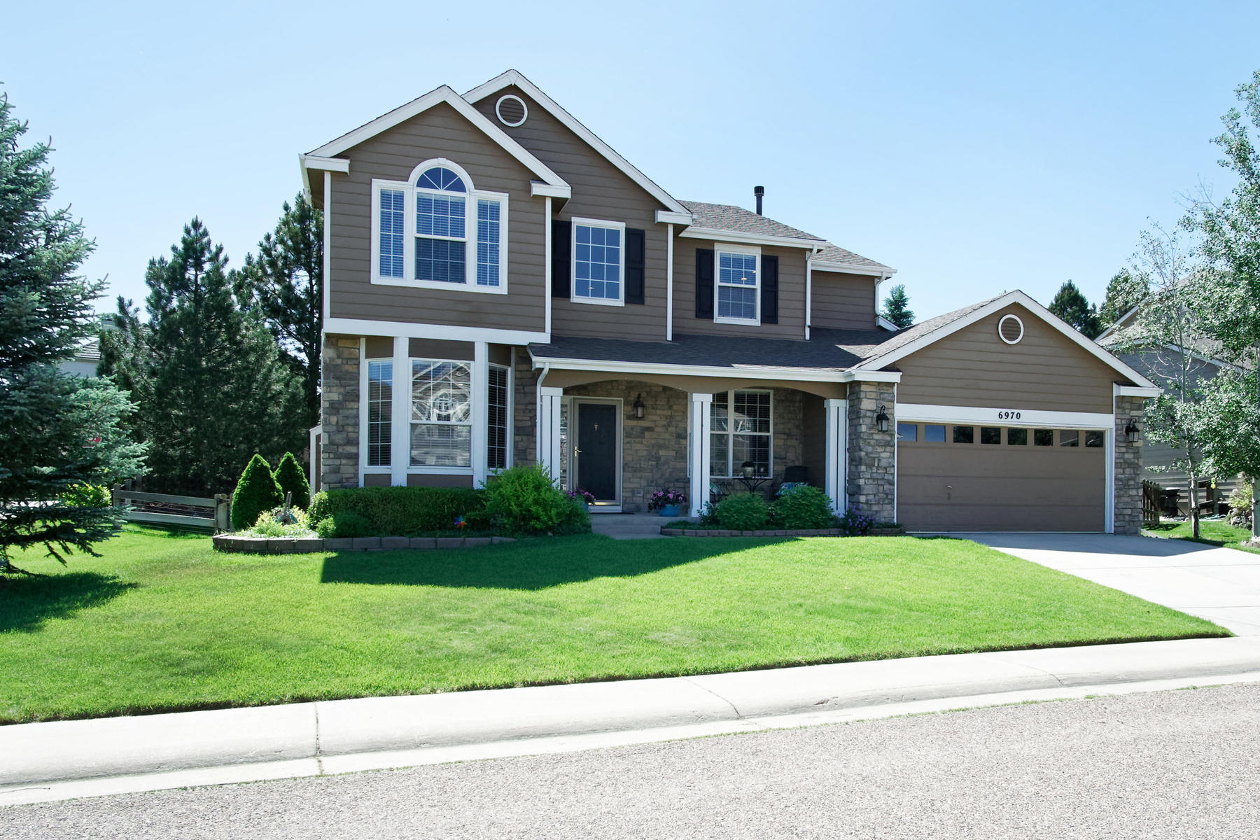 This beautiful, meticulously maintained home is located on a cul-de-sac in Castle Pines North.